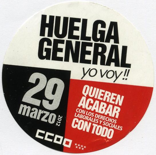 This circular sticker is blocked off into three different sections of white, red and black advertising a general strike held in Spain on March 29th, 2012.
