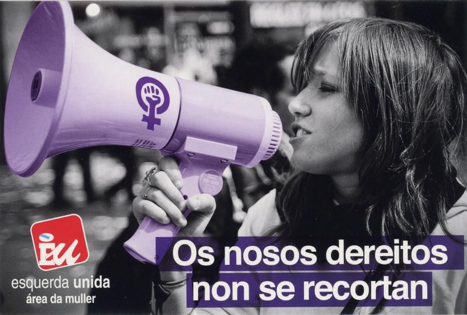 A woman with a purple loud speaker speaks out for woman's rights.