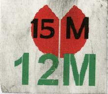 The image on the sticker is a red abstract flower, symbolizing protest. The text on the sticker refers to the dates, May 15th and May 12th of the year 2011.