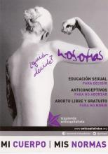 The sticker portrays the back of a naked woman with her right arm raised and her hand fisted upward. Her long blonde hair is tied up in a bun and her left arm sits at her side. On the bottom there is a purple star, which is the logo for the Anticapitalist Left Party in Spain.
